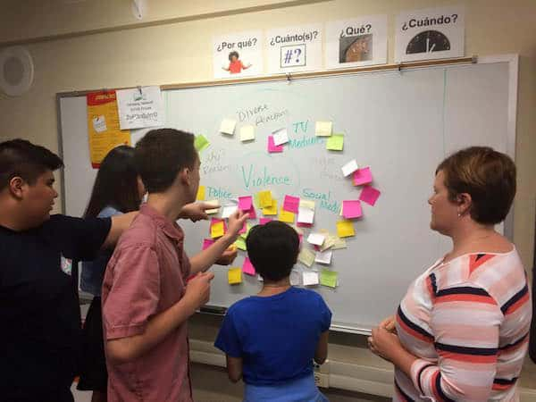 Facilitator Kinnereth Winegarner works with students in ideating for their solution to teen violence issues